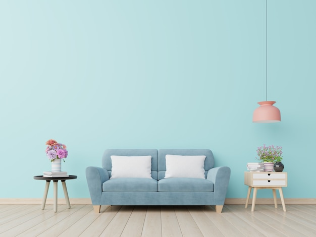 Blauwe muur woonkamer met blauwe bank.