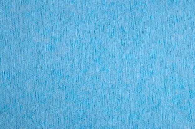 Blauwe niet-geweven stof textuur achtergrond