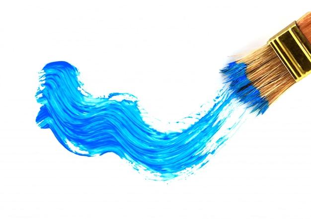 Blauwe olieverfstreek en penseel