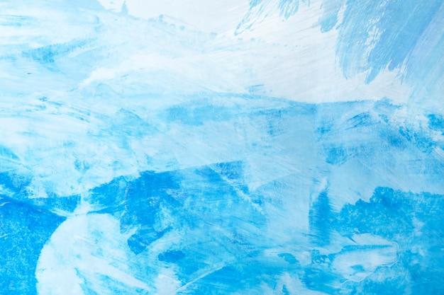 Blauwe penseelstreek getextureerde achtergrond