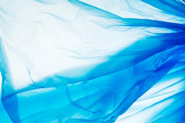 Blauwe plastic zaktextuur. blauwe plastic filmachtergrond. backgraund plastic textuur.