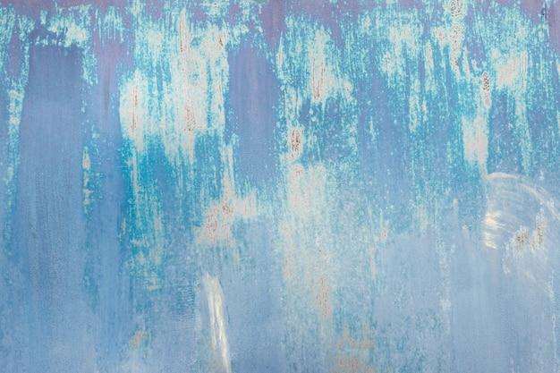 Blauwe roestige getextureerde metalen achtergrond. kopieer ruimte voor ontwerpers.