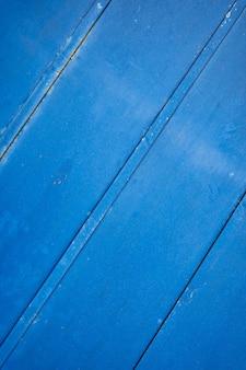 Blauwe roestige grunge metalen achtergrond of textuur met krassen en scheuren
