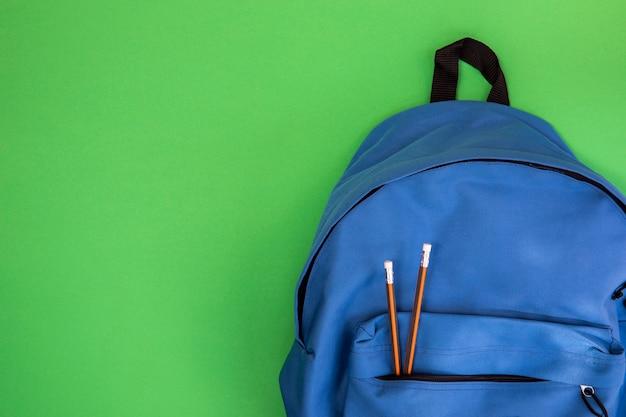 Blauwe school knapzak met potloden
