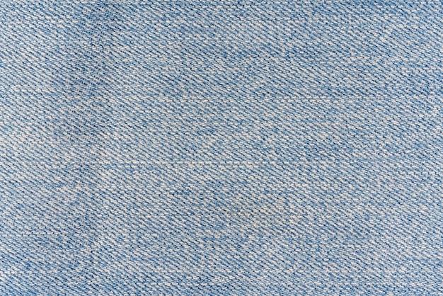 Blauwe sjofele denim textuur. abstracte textielachtergrond.