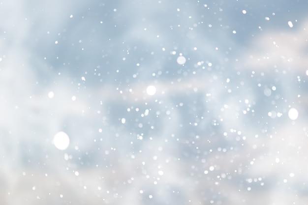 Blauwe sneeuwval bokeh achtergrond, abstracte sneeuwvlok achtergrond wazig abstract blue