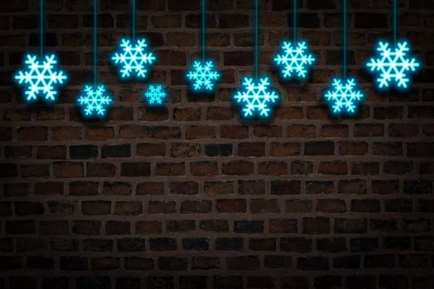 Blauwe sneeuwvlokken, neonteken op de achtergrond van de brandmuur. concept sneeuwval, nieuwjaarsvakantie en kerstmis, de winter.