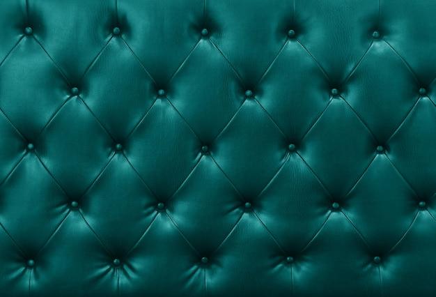 Blauwe sofa lederen achtergrond