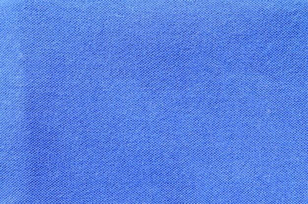 Blauwe sport jersey shirt kleding textuur en achtergrond