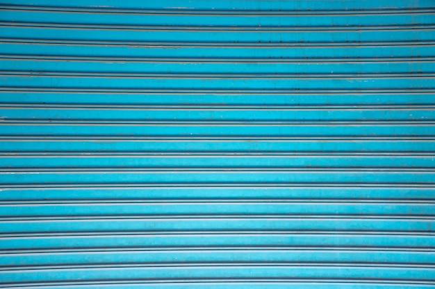 Blauwe stalen deur, textuur achtergrond
