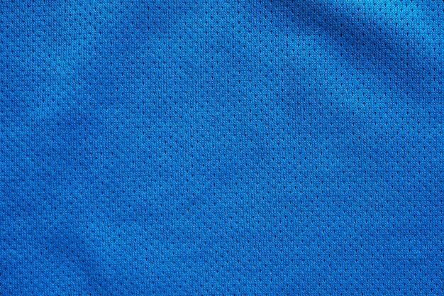Blauwe stof sportkleding voetbalshirt met lucht mesh textuur achtergrond