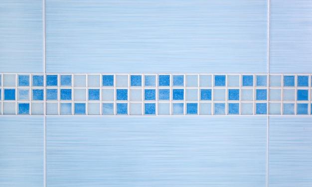 Blauwe tegels met rijmozaïek