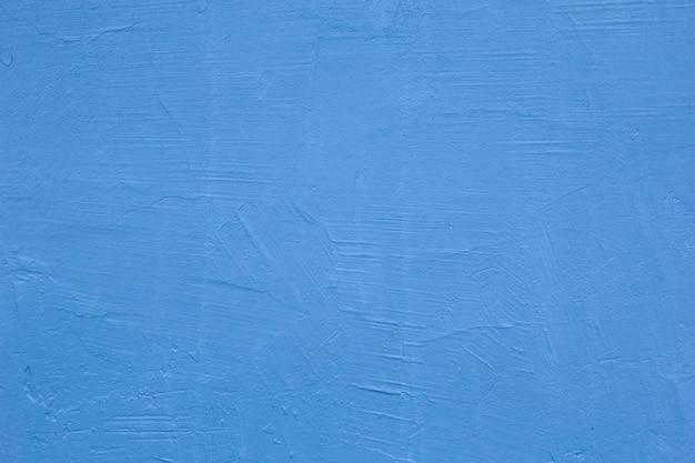 Blauwe textuur van de muren. heldere warme gele muur achtergrond. een oude gepleisterde muur.