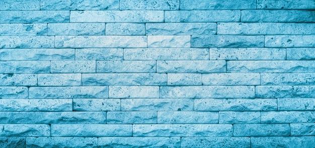 Blauwe textuur van stenen muur. hoge kwaliteit travertijn blokkeert achtergrond