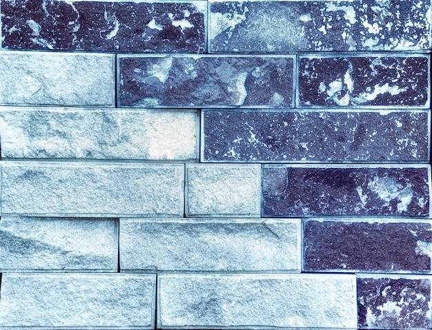 Blauwe textuur van stenen muur. hoogwaardige travertijnblokken.