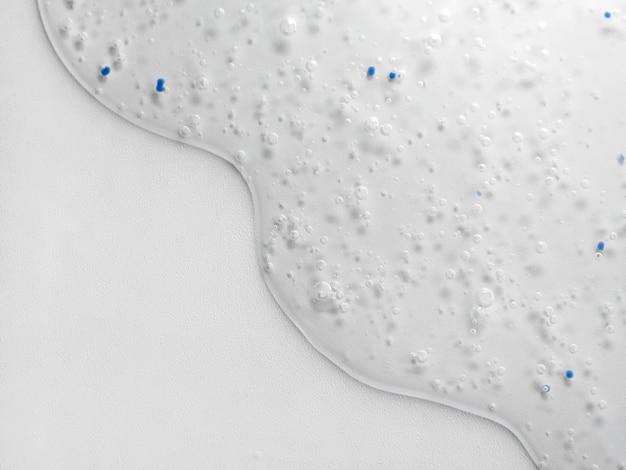 Blauwe transparante achtergrond vloeistof gel met zuurstofbellen antibacteriële gel, hyaluronzuur macro