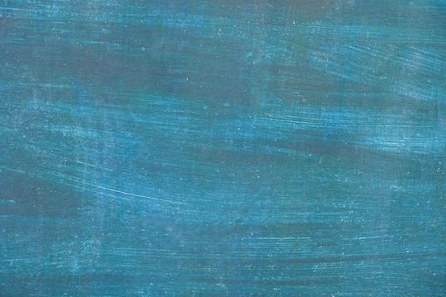 Blauwe verf op metalen oppervlak. blauwe muur.