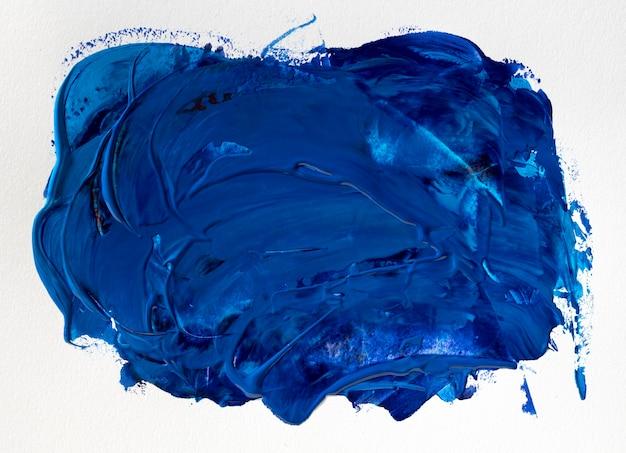 Blauwe verf vlek abstracte kunst
