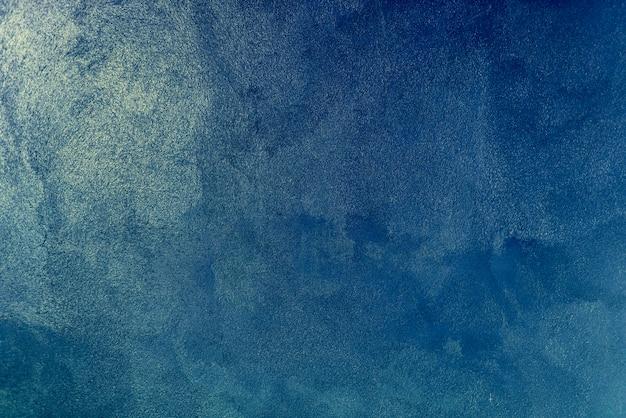 Blauwe verfmuur achtergrondstructuur