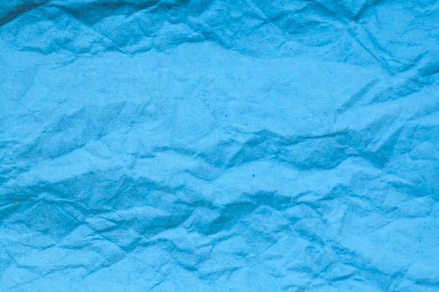 Blauwe verfrommeld papier achtergrond.