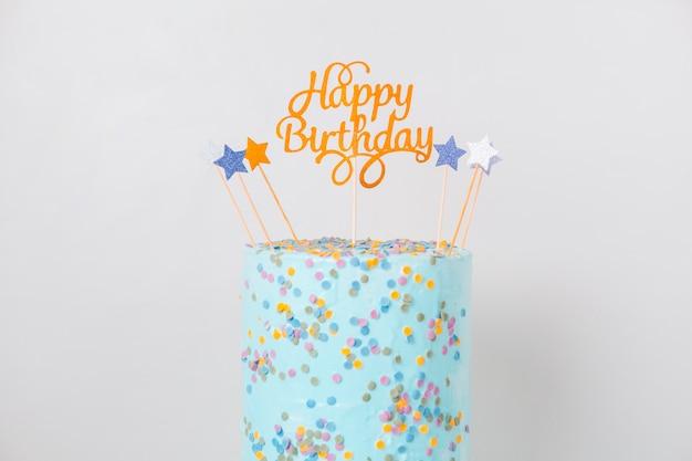 Blauwe verjaardagscake met topper