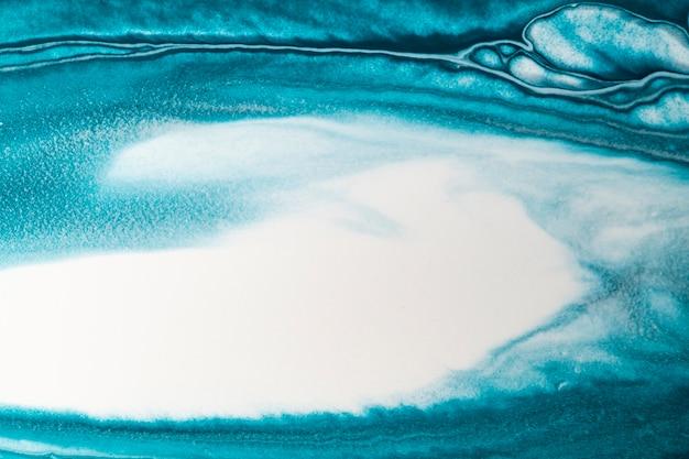 Blauwe vloeibare marmeren achtergrond diy vloeiende textuur experimentele kunst