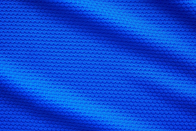 Blauwe voetbal trui kleding stof textuur sport slijtage achtergrond, close-up bovenaanzicht