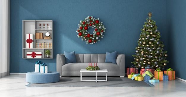 Blauwe woonkamer met kerstversiering