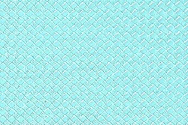 Bleke turquoise lederen achtergrond met imitatie weefsel textuur. glanzende kunstlederen structuur.