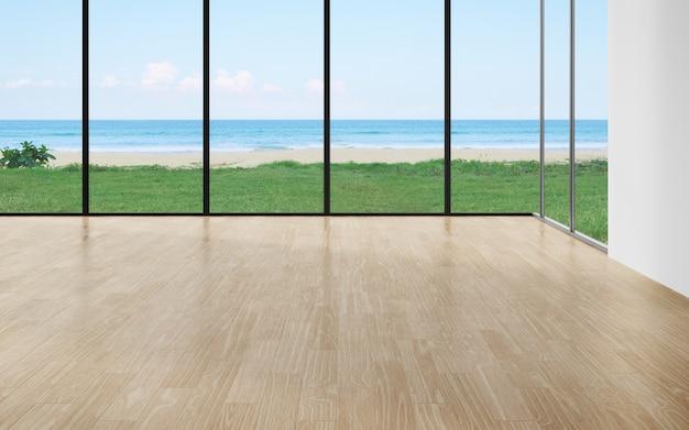 Blinde muur op de houten vloer van een grote woonkamer in een modern huis met uitzicht op het strand en de zee