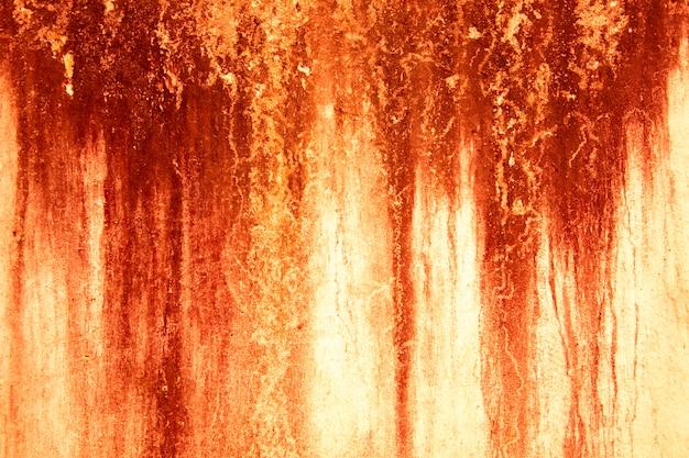 Bloed textuur achtergrond. textuur van betonnen wand met bloedige rode vlekken. halloween.