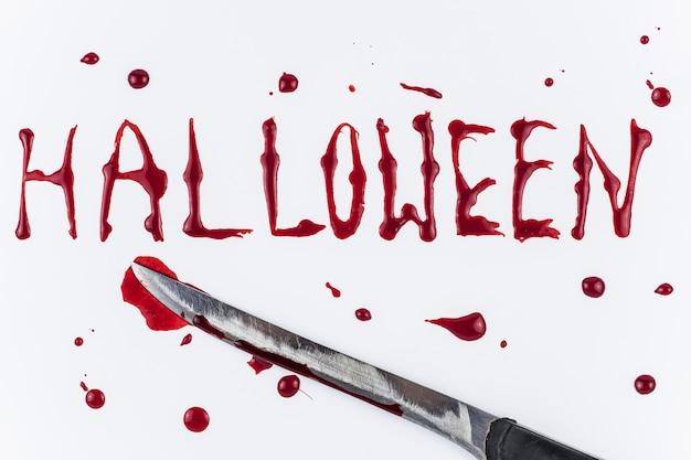 Bloedige halloween-woord en mes