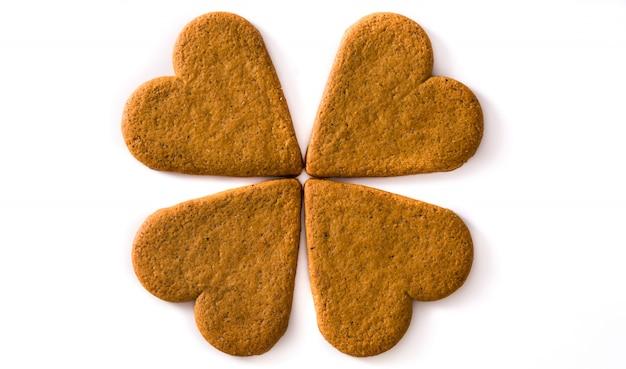 Bloem met hartkoekjes wordt op witte achtergrond worden geïsoleerd gemaakt die. valentijnsdag en moederdag concept.