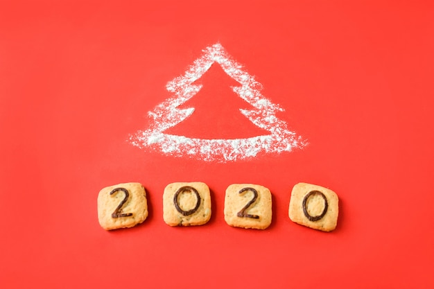 Bloem silhouet kerstboom met cookies cijfers