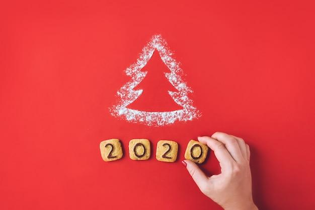 Bloem silhouet kerstboom met koekjes