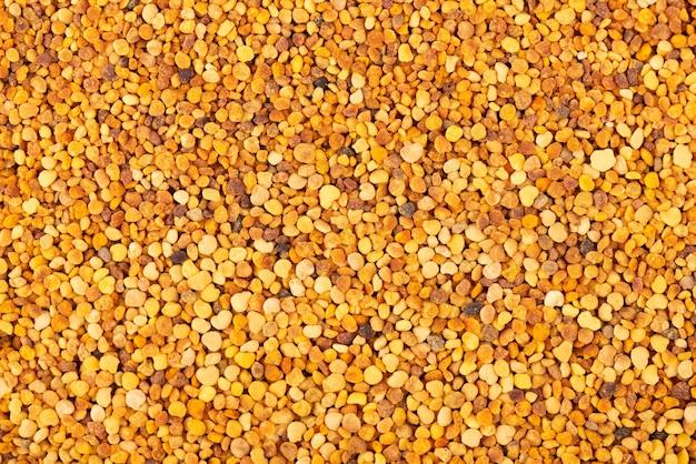 Bloem stuifmeel korrels achtergrond. stapel bijenpollen of perga.