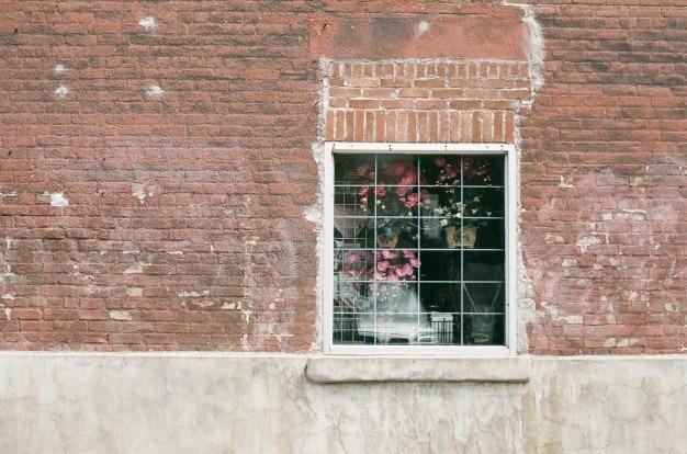 Bloemen dacht het raam