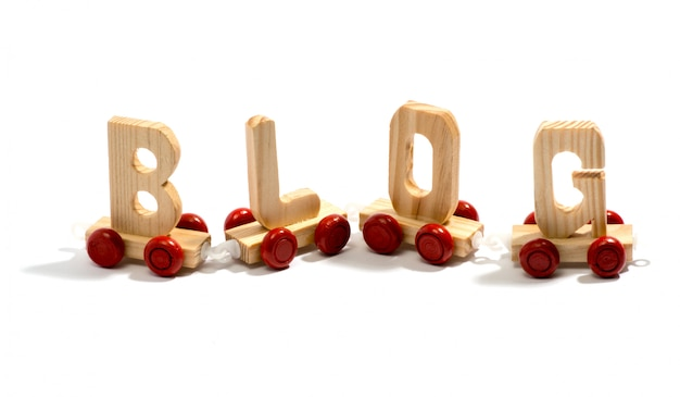 Blog in houten letters op wielen
