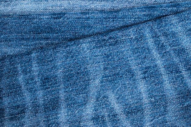 Blue jeans en steken textuur. denim achtergrond met naad