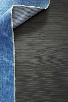 Blue jeans textuur op houten achtergrond