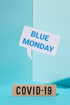 Blue maandag concept met covid-19 teken