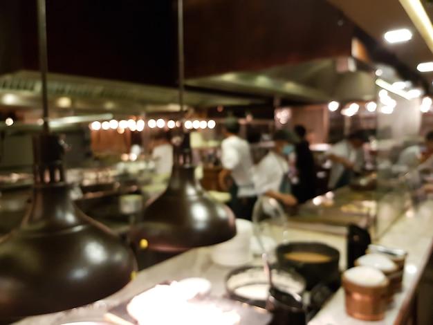 Blured of defocued image kitchen in restaurant