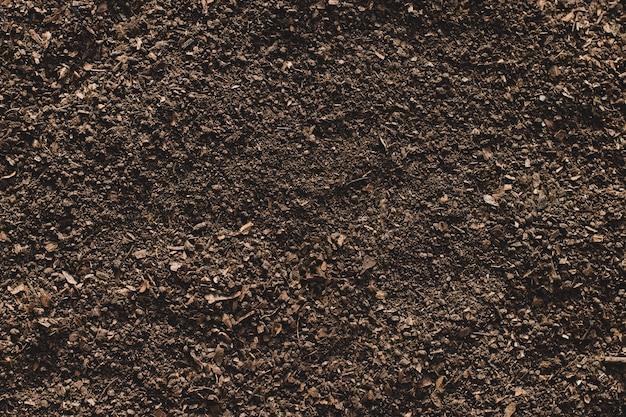 Bodemtextuurachtergrond, vruchtbare grond voor opplant.