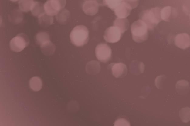 Bokeh achtergrond met donker stoffig roze