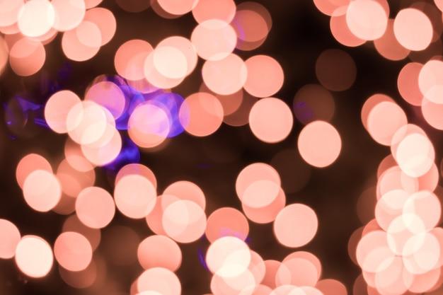 Bokeh defocused-ligths van gouden kerstboomachtergrond