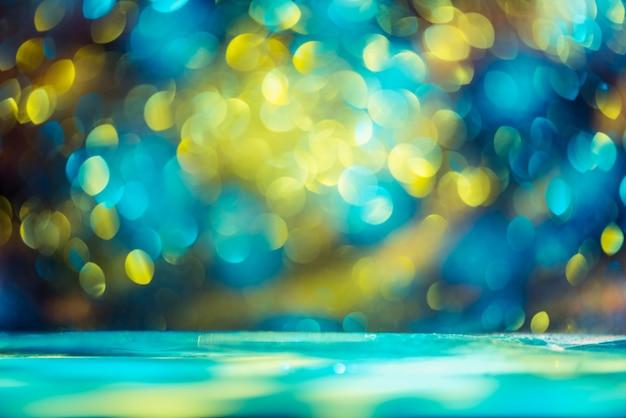 Bokeh glitter kleurrijke wazig abstracte achtergrond voor verjaardag, oudejaarsavond of kerstmis