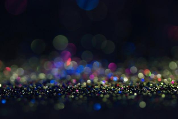 Bokeh schittert vlieg en lichten op zwarte