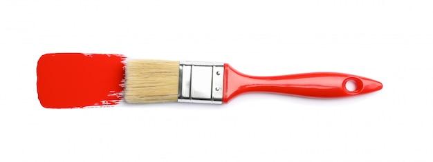 Borstel met rode verf geïsoleerd op een witte ondergrond