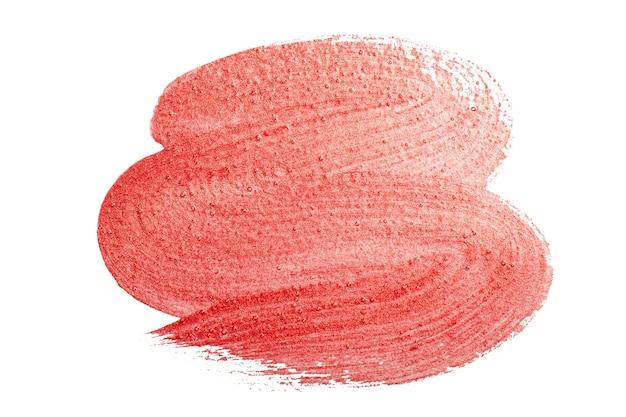 Borstel van parelrode verf op een witte achtergrond rode verftextuur isoleer foto van hoge kwaliteit