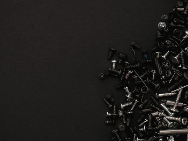 Bouten en schroeven donkere textuur en compositie voor creatieve technische projecten